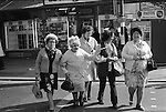 Senior  Hen Do, mature women having a party Girls day out, Grannies. Blackpool the Golden Mile. Lancashire England. 1974.<br /> <br /> L-R Mrs May Brindle, Mrs Bertha Law (Nee Booth), Mrs Edna Payne, unknown lady with linked arms and Mrs Lily Moxham. All from Oswaldtwistle a mill town in East Lancashire. They all worked at the Vine Mill.<br /> <br /> Names thanks to Mrs Bertha Law's grand-daughter Stephanie Kemp.