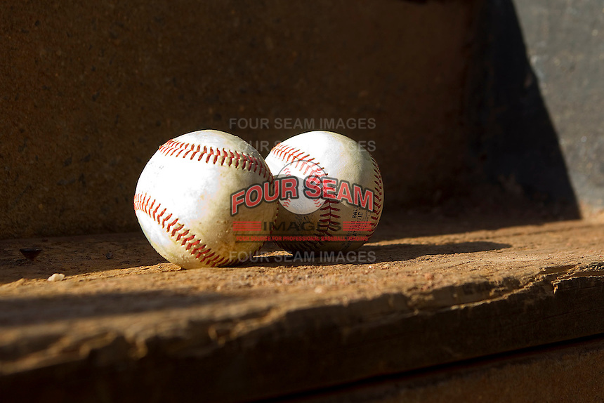 South Atlantic League baseballs sit on the dugout steps at L.P. Frans Stadium on April 29, 2011 in Hickory, North Carolina.   Photo by Brian Westerholt / Four Seam Images