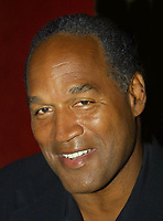 EXCLUSIVE<br /> Miami Beach, FL 2-7-02<br /> OJ Simpson enjoys a night out<br /> at KISS Restaurant in South Beach.<br /> Photo by Adam Scull/PHOTOlink