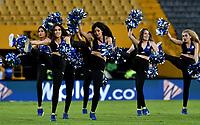 BOGOTÁ-COLOMBIA, 28–04-2019: Porristas de Millonarios animan a su equipo durante partido de la fecha 18 entre Millonarios y Atlético Junior, por la Liga Águila I 2019, jugado en el estadio Nemesio Camacho El Campín de la ciudad de Bogotá. / Cheerleaders of Millonarios cheer for their team during a match of the 18th date between Millonarios and Atletico Junior, for the Aguila Leguaje I 2019 played at the Nemesio Camacho El Campin Stadium in Bogota city, Photo: VizzorImage / Luis Ramírez / Staff.