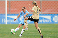 Laura Kalmari (21) of Sky Blue FC passes the ball as Carrie Dew (19) of FC Gold Pride defends. FC Gold Pride defeated Sky Blue FC 1-0 during a Women's Professional Soccer (WPS) match at Yurcak Field in Piscataway, NJ, on May 1, 2010.
