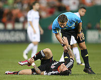 Santino Quaranta #25 of D.C. United is injured during an MLS match against the San Jose Earthquakes at RFK Stadium in Washington D.C. on October 9 2010. San Jose won 2-0.