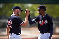 AZL Indians Blue Eric Mock (52) congratulates relief pitcher Luis C. Garcia (70) between innings of an Arizona League game against the AZL Indians Red on July 7, 2019 at the Cleveland Indians Spring Training Complex in Goodyear, Arizona. The AZL Indians Blue defeated the AZL Indians Red 5-4. (Zachary Lucy/Four Seam Images)