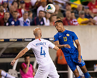 PHILADELPHIA, PA - JUNE 30: Jurien Gaari #13 heads the ball over Michael Bradley #4 during a game between Curaçao and USMNT at Lincoln Financial Field on June 30, 2019 in Philadelphia, Pennsylvania.