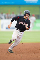 Brett Austin (10) of the Kannapolis Intimidators hustles towards third base against the Lakewood BlueClaws at CMC-NorthEast Stadium on July 20, 2014 in Kannapolis, North Carolina.  The Intimidators defeated the BlueClaws 7-6. (Brian Westerholt/Four Seam Images)