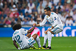 Marcelo Vieira Da Silva of Real Madrid is helped up by teammate Cristiano Ronaldo during the UEFA Champions League 2017-18 match between Real Madrid and APOEL FC at Estadio Santiago Bernabeu on 13 September 2017 in Madrid, Spain. Photo by Diego Gonzalez / Power Sport Images