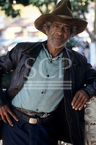 Sao Paulo State, Brazil. Man with a beard wearing a hat and a leather jacket.