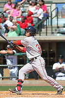 Greenville Drive infielder Tzu-Wei Lin at bat during a game against the Charleston RiverDogs at Joseph P. Riley Jr. Ballpark  on April 9, 2014 in Charleston, South Carolina. Greenville defeated Charleston 6-3. (Robert Gurganus/Four Seam Images)