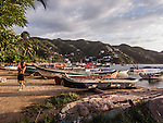 Sunset on the beach at Taganga near Santa Marta, Colombia.   The once small fishing village on the Caribbean has become a popular hub for tourists visiting nearby Tayrona National Park.