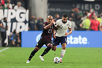 LAS VEGAS, NV - AUGUST 1: Luis Rodriguez #21 of Mexico battles for the ball with Sebastian Lletget #17 of the United States during a game between Mexico and USMNT at Allegiant Stadium on August 1, 2021 in Las Vegas, Nevada.