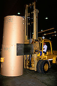 Vitoria, Brazil. Forklift truck stacking rolls of paper in the warehouse of the Aracruz paper factory.
