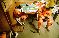 "Exhausted crewmen crash in the galley of the fishing vessel Polar Lady while their boat travels to the next string of pots. Crabbers sleep four to six hours a night, less when the fishing is good. They work seven days a week for several months. There is no such thing as sympathy on a crab boat. With only a crew of five or six men, the sick or injured can't go to bed and recuperate. Crabbers often exist on one hot meal, sandwiches, candy bars, sodas, and a staple of ibuprofen and flu medicines.  The Bering Sea is known for having the worst storms in the world. Crab fishing in the Bering Sea is considered to be one of the most dangerous jobs in the world.  This fishery is managed by the Alaska Department of Fish and Game and is a sustainable fishery.  The Discovery Channel produced a TV series called ""The Deadliest Catch"" which popularized this fishery."