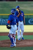 AZL Cubs 1 relief pitcher Pablo Ochoa (43) talks to catcher Richard Nunez (5) during an Arizona League game against the AZL Athletics Gold at Sloan Park on June 20, 2019 in Mesa, Arizona. AZL Athletics Gold defeated AZL Cubs 1 21-3. (Zachary Lucy/Four Seam Images)