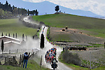 The peloton tackle sector 5 Lucignano d'Asso during the Strade Bianche 2019 running 184km from Siena to Siena, held over the white gravel roads of Tuscany, Italy. 9th March 2019.<br /> Picture: LaPresse/Fabio Ferrari   Cyclefile<br /> <br /> <br /> All photos usage must carry mandatory copyright credit (© Cyclefile   LaPresse/Fabio Ferrari)