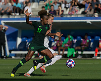 GRENOBLE, FRANCE - JUNE 22: Alexandra Popp #11 of the German National Team attempts to control the ball  as Francisca Ordega #17 of the Nigerian National Team pressures during a game between Nigeria and Germany at Stade des Alpes on June 22, 2019 in Grenoble, France.