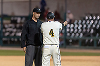 Visalia Rawhide manager Shawn Roof (4) argues a call with field umpire Ty Kraus during a California League game against the Rancho Cucamonga Quakes on April 9, 2019 in Visalia, California. Visalia defeated Rancho Cucamonga 8-5. (Zachary Lucy/Four Seam Images)