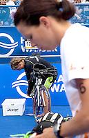 17 JUL 2011 - HAMBURG, GER - Rachel Klamer (NED) (back) and Danne Boterenbrood (NED) prepare in transition for the start of the women's Hamburg round of triathlon's ITU World Championship Series (PHOTO (C) NIGEL FARROW)