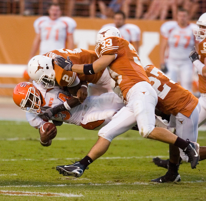 30 September 2006: Sam Houston State back D.D. Terry (#34) is tackled by a gang of Longhorns including Sergio Kindle (#2) and Michael Griffin (#27) during the Bearkats 56-3 loss to the University of Texas Longhorns at Darrell K Royal Memorial Stadium in Austin, TX.