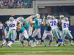 Miami Dolphins quarterback Ryan Tannehill (17), Dallas Cowboys defensive tackle Josh Brent (92) and Dallas Cowboys tackle Tyrone Crawford (70) in action during the pre- season game between the Miami Dolphins and the Dallas Cowboys at the Cowboys Stadium in Arlington, Texas. Dallas defeats Miami 30 to 13...