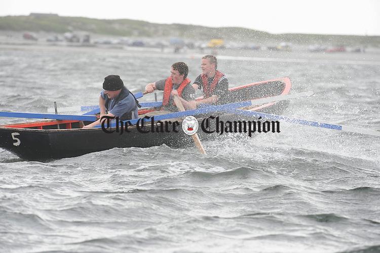 Paul O Looney, Jason Honan and Kieran Browne of Doonbeg taking part at the Leon Currach Regatta at Seafield, Quilty. Photograph by John Kelly.