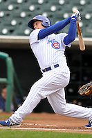 Chris Valaika #4 of the Iowa Cubs swings against the Omaha Storm Chasers at Principal Park on May 1, 2014 in Des Moines, Iowa. The Cubs  beat Storm Chasers 1-0.   (Dennis Hubbard/Four Seam Images)