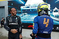 26th September 2021; Sochi, Russia; F1 Grand Prix of Russia, Race Day:   4 Lando Norris GBR, McLaren F1 Team is hugged by 44 Lewis Hamilton GBR, Mercedes-AMG Petronas F1 Team as Norris lost the lead to Hilton as heavy rain fell late in the race and Norris finished in 6th place