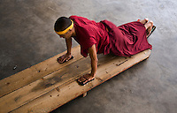 A TIBETAN MONK does prostrations at the NAMGYAL GOMPA or MONASTERY which is a GALUKPA SECT INSTITUTION of the 14th DALAI LAMA in MCLEOD GANG - DHARMSALA, INDIA