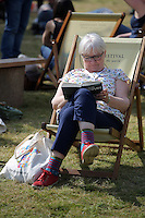 Hay on Wye. Friday 03 June 2016<br />A woman rests on the festival green at the Hay Festival, Hay on Wye, Wales, UK