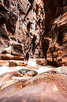 A hiker inside spectacular Wadi Mujib canyon, Jordan <br />