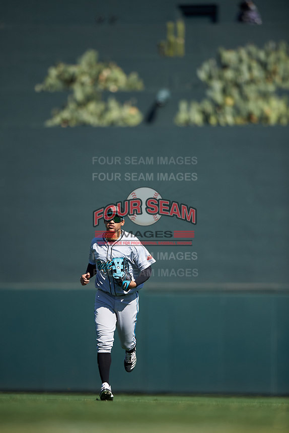 Salt River Rafters center fielder Victor Victor Mesa (10), of the Miami Marlins organization, jogs off the field between innings of the Arizona Fall League Championship Game against the Surprise Saguaros on October 26, 2019 at Salt River Fields at Talking Stick in Scottsdale, Arizona. The Rafters defeated the Saguaros 5-1. (Zachary Lucy/Four Seam Images)
