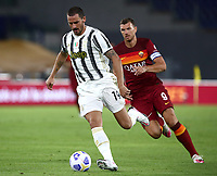 Football, Serie A: AS Roma - Juventus, Olympic stadium, Rome, September 27, 2020. <br /> Juventus' Leonardo Bonucci (l) in action with Roma's captain Edin Dzeko (r) during the Italian Serie A football match between Roma and Juventus at Olympic stadium in Rome, on September 27, 2020. <br /> UPDATE IMAGES PRESS/Isabella Bonotto