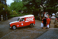 Coca-Cola delivery truck and three women talking on street corner. Toledo Castilla-La Mancha Spain.