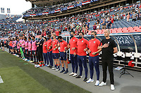 DENVER, CO - JUNE 3: USMNT head coach Gregg Berhalter and his staff line up for the playing of the national anthem during a game between Honduras and USMNT at Empower Field at Mile High on June 3, 2021 in Denver, Colorado.