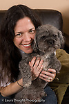 portrait of woman with her pet dog vertical Caucasian