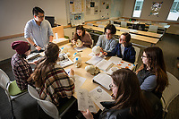 Students learn to identify features of the human skull using models during Professor Ryan Harrod's Biological Anthropology Lab (ANTH A205L) in UAA's Beatrice McDonald Hall.