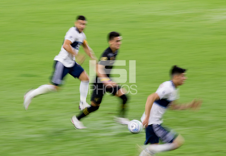LOS ANGELES, CA - SEPTEMBER 23: Eduard Atuesta #20 of LAFC moves with the ball during a game between Vancouver Whitecaps and Los Angeles FC at Banc of California Stadium on September 23, 2020 in Los Angeles, California.