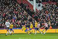 Sheffield United's defender George Baldock (2) shoots during the Sky Bet Championship match between Sheff United and Leeds United at Bramall Lane, Sheffield, England on 1 December 2018. Photo by Stephen Buckley / PRiME Media Images.