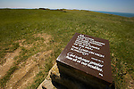 One of the UK's most famous landmarks the cliff face at Beachy Head on the South Downs is also notorious as a suicide spot. Warning signs and flower memorials are on the cliff edge as well as this plaque ontop of the cliffs.