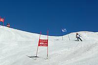 Switzerland. Valais. Crans Montana. Winter ski resort. Micaela Ruef in the ski competition (giant slalom) organised by the Swiss Ski School. Blue sky on a sunny day. © 2005 Didier Ruef
