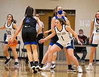 Aubrey Treadwell (2) of Rogers looks for open player, as Maysa Willis (1) of Bentonville West defends at Wolverine Arena, Centerton,  AR, Tuesday, January 12, 2021 / Special to NWA Democrat-Gazette/ David Beach