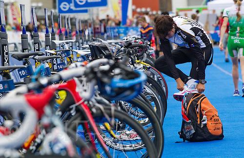 17 JUL 2011 - HAMBURG, GER - Kathrin Muller (GER) prepares in transition for the start of the women's Hamburg round of triathlon's ITU World Championship Series (PHOTO (C) NIGEL FARROW)