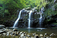 The road to Hana, Maui has many beautiful sights including this waterfall and pool.