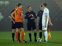 Pictured: match referee Simon Barrow (C) flips the coin for Conor Levingston of Wolverhampton Wanderers (L) and Keston Davies of Swansea City (R) Monday 13 March 2017<br /> Re: Premier League 2, Swansea City U23 v Wolverhampton Wanderers FC at the Liberty Stadium, Swansea, UK