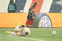 FOXBOROUGH, MA - NOVEMBER 1: Adam Buksa #9 of New England Revolution fouled by Russell Canouse #4 of DC United during a game between D.C. United and New England Revolution at Gillette Stadium on November 1, 2020 in Foxborough, Massachusetts.