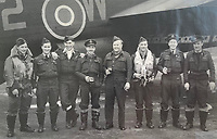 BNPS.co.uk (01202) 558833. <br /> Pic: Spink&Son/BNPS<br /> <br /> Pictured: Wing Commander Sidney 'Tubby' Baker, centre right.  <br /> <br /> The bravery medals of a larger-than-life hero Pathfinder pilot who clocked up a staggering 100 bombing raids have emerged for sale for £32,000.<br /> <br /> Wing Commander Sidney 'Tubby' Baker, who was known for his love of food, drink and cigarettes, repeatedly risked his life in attacks on heavily defended German and Italian targets.<br /> <br /> Upon returning to his airbase after completing his century, the No 635 Squadron commander was handed a well-earned pint of beer and 'grounded with immediate effect'.<br /> <br /> As was his custom, he downed the drink and puffed on a celebratory cigarette.