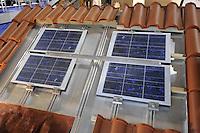 - Milan, Trade Fair of Robotics, High Tech and Green Energy; roof with photovoltaic modules integrated into the tiles<br /> <br /> - Milano, Fiera della Robotica, High Tech ed Energie Verdi; tetto con moduli fotovoltaici integrati nelle tegole