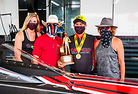 Jul 12, 2020; Clermont, Indiana, USA; NHRA top fuel driver Billy Torrence celebrates with wife Kay Torrence and son Steve Torrence and wife Natalie Torrence after winning the E3 Spark Plugs Nationals at Lucas Oil Raceway. This is the first race back for NHRA since the start of the COVID-19 global pandemic. Mandatory Credit: Mark J. Rebilas-USA TODAY Sports