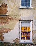 Bishop Hill, IL<br /> Blue glassware in shop window & textured brick wall  Bishop Hill State Historic Site, IL