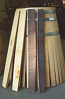A half finished barrel made from Swedish oak but in the traditional fashion of wine barrel coopers. The staves have only been closed for half of the vat. Four staves that will be used for a barrel that show the different degrees of toasting (chauffe, charring). The barrel is burned on the inside to char the staves. This gives different characteristics to the wine depending on how much charring (toasting) takes place.