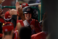 Batavia Muckdogs Nic Ready (5) high fives teammates after scoring a run during a NY-Penn League game against the Auburn Doubledays on June 18, 2019 at Dwyer Stadium in Batavia, New York.  Batavia defeated Auburn 7-5.  (Mike Janes/Four Seam Images)